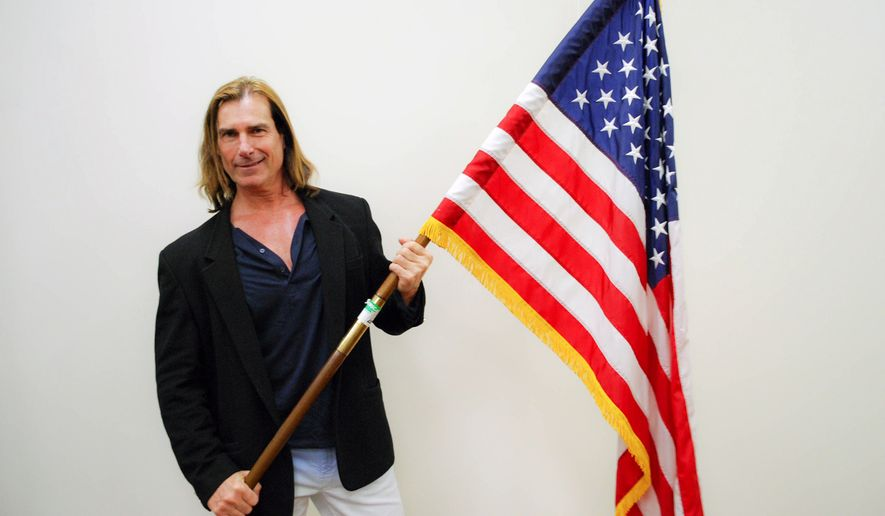 In this Wednesday, March 16, 2016, photo released by U.S. Citizenship and Immigration Services (USCIS), model Fabio poses during a naturalization ceremony at the Los Angeles Convention Center in Los Angeles. Fabio, real name Fabio Lanzoni, the long-locked blonde Italian who became a cultural phenomenon in the 1990s, became a naturalized American citizen on Wednesday. (U.S. Citizenship and Immigration Services via AP)