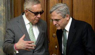 Senate Minority Leader Harry Reid, D-Nev., left, meets Supreme Court nominee Judge Merrick Garland in his office on Capitol Hill in Washington, Thursday, March 17, 2016.  (AP Photo/Manuel Balce Ceneta)