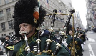 In this March 17, 2015 photo, bagpipers march up Fifth Avenue during the St. Patrick's Day Parade in New York. Tracing its history to 1762, the parade features about 200,000 marchers. (AP Photo/Mary Altaffer, File)