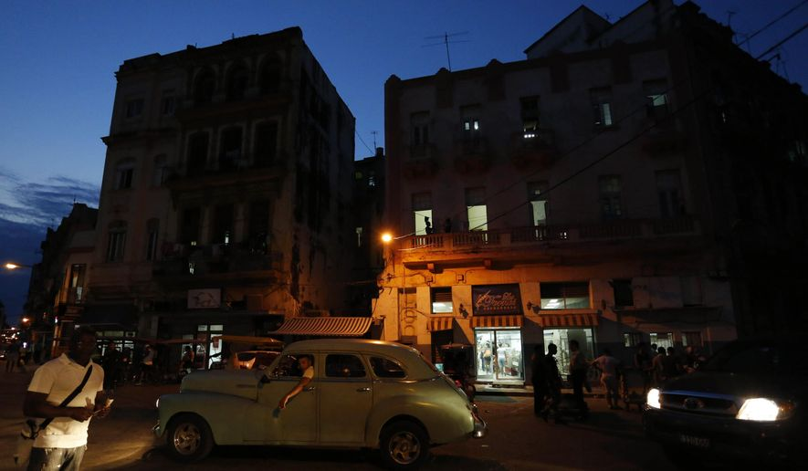 People make their way along Neptuno Street at dusk in downtown Havana, Cuba, Wednesday, March 16, 2016. U.S. President Barack Obama will travel to Cuba on March 20. The trip will mark a watershed moment in U.S.-Cuba relations, making Obama the first sitting U.S. president to set foot on the island in nearly seven decades. (AP Photo/Desmond Boylan)