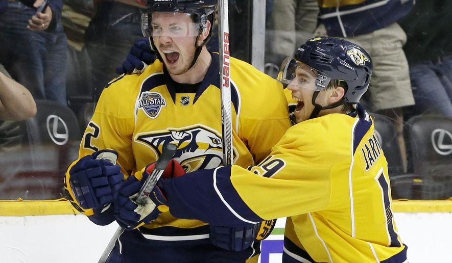Nashville Predators center Ryan Johansen (92) is congratulated by Calle Jarnkrok (19), of Sweden, after scoring a goal against the New York Islanders in the second period of an NHL hockey game Thursday, March 17, 2016, in Nashville, Tenn. (AP Photo/Mark Humphrey)