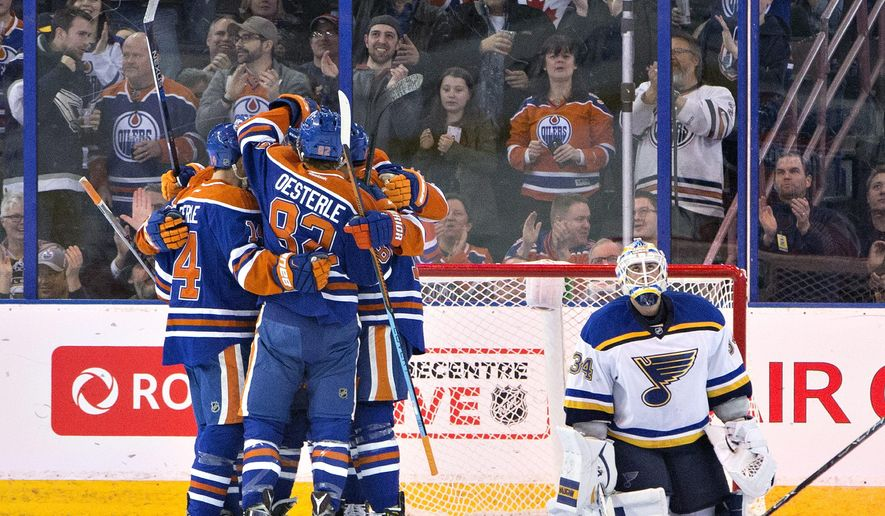 St. Louis Blues goalie Jake Allen (34) looks on as the Edmonton Oilers celebrate a goal during the first period of an NHL hockey game, Wednesday, March 16, 2016 in Edmonton, Alberta. (Jason Franson/The Canadian Press via AP) MANDATORY CREDIT