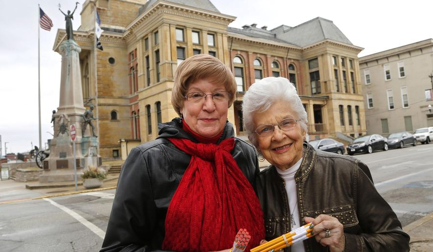 Sandy Lofland-Brown, left, and Jean Chadwick stand outside the Montgomery County Courthouse on March 7, 2016 in downtown Crawfordsville, Ind. Lofland-Brown, aided by Chadwick, has spent the past 20 years spearheading the Clocktower Project to restore the clocktower on the courthouse, which was removed in 1941. (John Terhune/Journal & Courier via AP) MANDATORY CREDIT; NO SALES; TV OUT; RADIO OUT; LOCAL INTERNET OUT