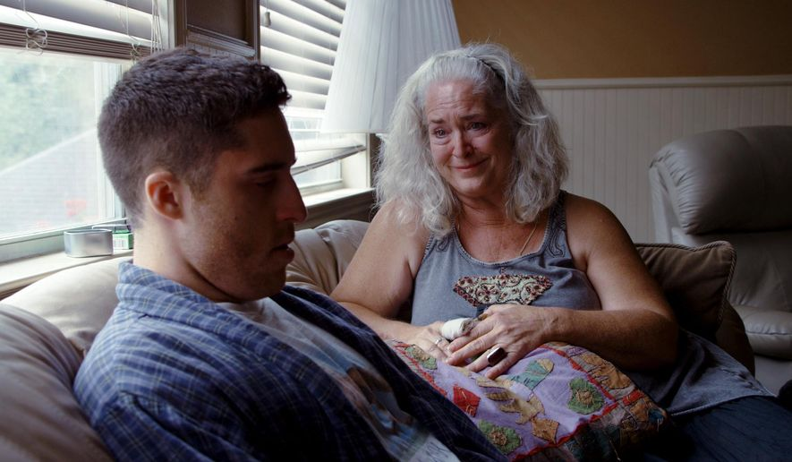 """This image released by A24 Films shows director Trey Edward Shults, left, with Krisha Fairchild during the filming of, """"Krisha."""" Shults made his debut film in nine days with less than $100,000, shooting at his mother's house and starring his aunt. The resulting film """"Krisha"""" has earned acclaim, been celebrated at festivals from SXSW to Cannes and earned a Spirit Award. (A24 Films via AP)"""