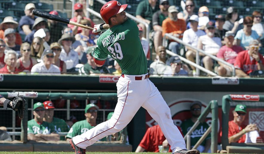 Cincinnati Reds' Devin Mesoraco hits a two-run home run during the first inning of a spring training baseball game against the Cleveland Indians on Thursday, March 17, 2016, in Goodyear, Ariz. (AP Photo/Darron Cummings)