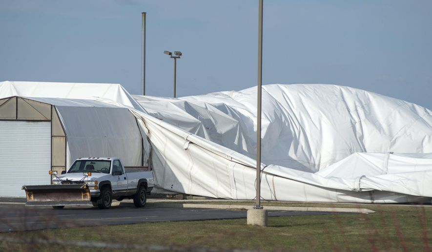 A truck drives by the Kokomo's Family Fun Center Sports and Golf Dome on March 17, 2016. The dome collapsed under heavy snow during a snow last month.   Jeff Schrier/The Saginaw News via AP) ALL LOCAL TELEVISION OUT; LOCAL TELEVISION INTERNET OUT; MANDATORY CREDIT