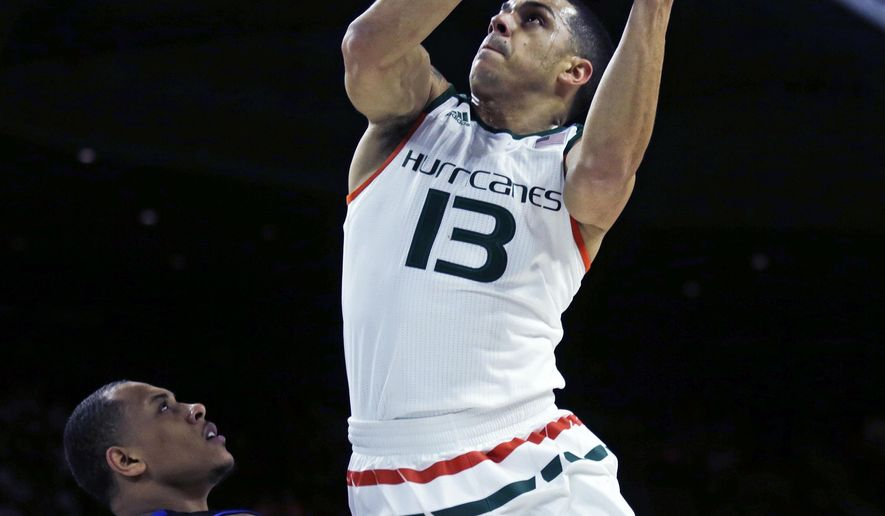 Miami guard Angel Rodriguez (13) drives to the basket against Buffalo guard Rodell Wigginton (20) during the first half of a first-round game in the NCAA college men's basketball tournament in Providence, R.I., Thursday, March 17, 2016. (AP Photo/Charles Krupa)