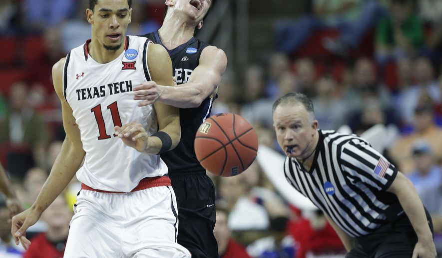 Texas Tech forward Zach Smith (11) and Butler guard Kellen Dunham (24) collide during the second half of a first-round men's college basketball game in the NCAA Tournament, Thursday, March 17, 2016, in Raleigh, N.C. (AP Photo/Chuck Burton)
