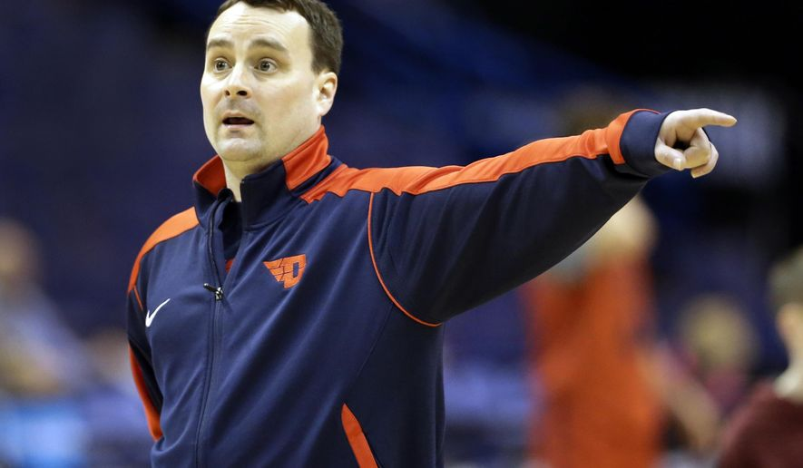 Dayton head coach Archie Miller points during practice ahead of a first-round men's college basketball game in the NCAA Tournament, Thursday, March 17, 2016, in St. Louis. Dayton plays Syracuse on Friday. (AP Photo/Jeff Roberson)