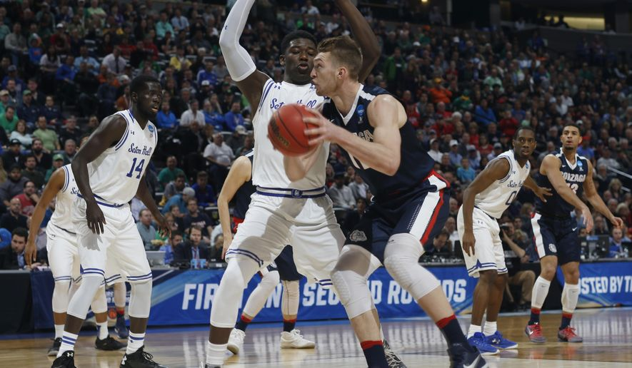 Gonzaga forward Domantas Sabonis, front, drives as Seton Hall forward Angel Delgado defends during the first half of a first-round game Thursday, March 17, 2016, in the NCAA men's tournament in Denver. (AP Photo/David Zalubowski)