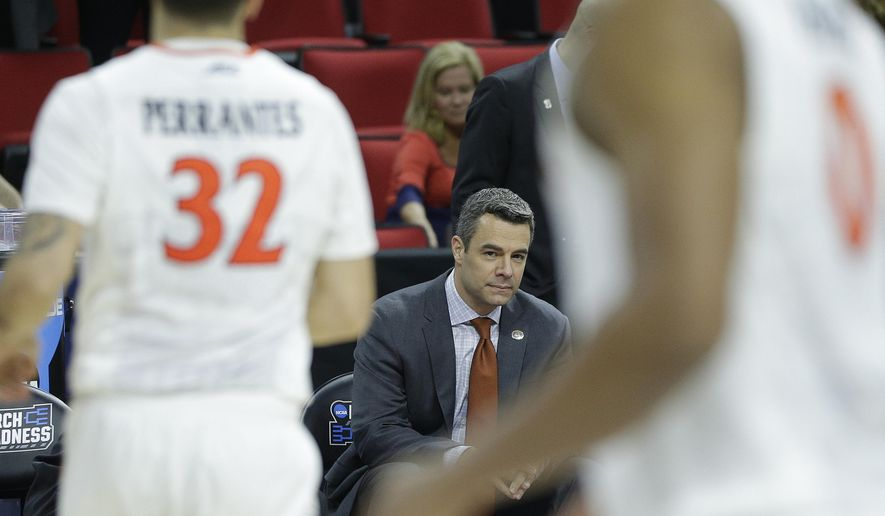 Virginia head coach Tony Bennett sits on the bench before the second half of a first-round men's college basketball game in the NCAA Tournament against Hampton, Thursday, March 17, 2016, in Raleigh, N.C. Bennett collapsed and left the court in the first half. (AP Photo/Chuck Burton)