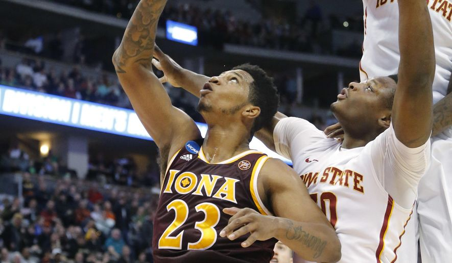 Iona forward Jordan Washington, left, has his shot blocked by Iowa State forward Jameel McKay, right, as guard Deonte Burton defends in the first half of a first-round men's college basketball game Thursday, March 17, 2016, in the NCAA Tournament in Denver. (AP Photo/Brennan Linsley)
