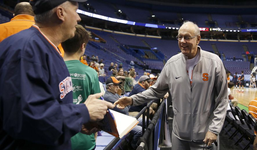 Syracuse head coach Jim Boeheim, right, talks with fans during practice for a first-round men's college basketball game in the NCAA tournament, Thursday, March 17, 2016, in St. Louis. Syracuse plays Dayton on Friday. (AP Photo/Jeff Roberson)