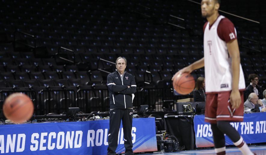 Temple head coach Fran Dunphy watches Devontae Watson (23) during practice for a first-round men's college basketball game in the NCAA Tournament on Thursday, March 17, 2016, in New York. Temple faces Iowa on Friday in New York. (AP Photo/Frank Franklin II)