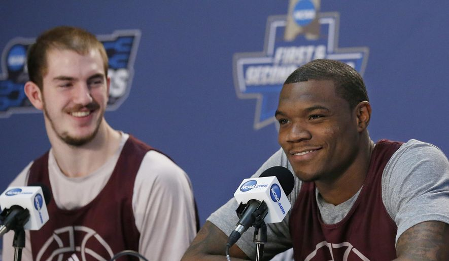 Texas A&M guard Jalen Jones, center, answers a question as teammate Alex Caruso, left, looks on, during a news conference on a practice day for a first-round men's college basketball game in the NCAA Tournament, Thursday, March 17, 2016, in Oklahoma City. (AP Photo/Sue Ogrocki)