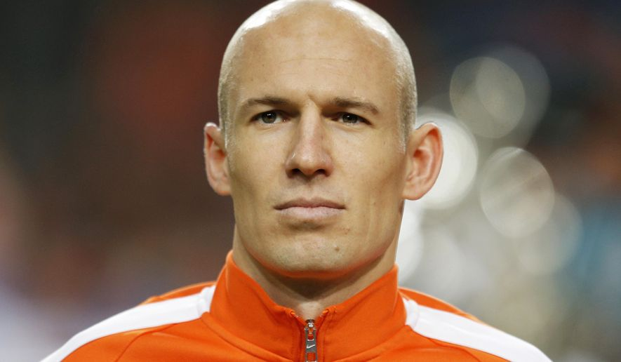 In this Nov. 16, 2014 photo Netherlands' Arjen Robben lines up prior to the Euro 2016 group A qualifying round soccer match between the Netherlands and Latvia at ArenA stadium in Amsterdam, Netherlands. Robben announced Thursday March 17, 2016, that he has pulled out of the Dutch squad ahead of the friendlies against France and England later this month with a thigh injury. (AP Photo/Peter Dejong)