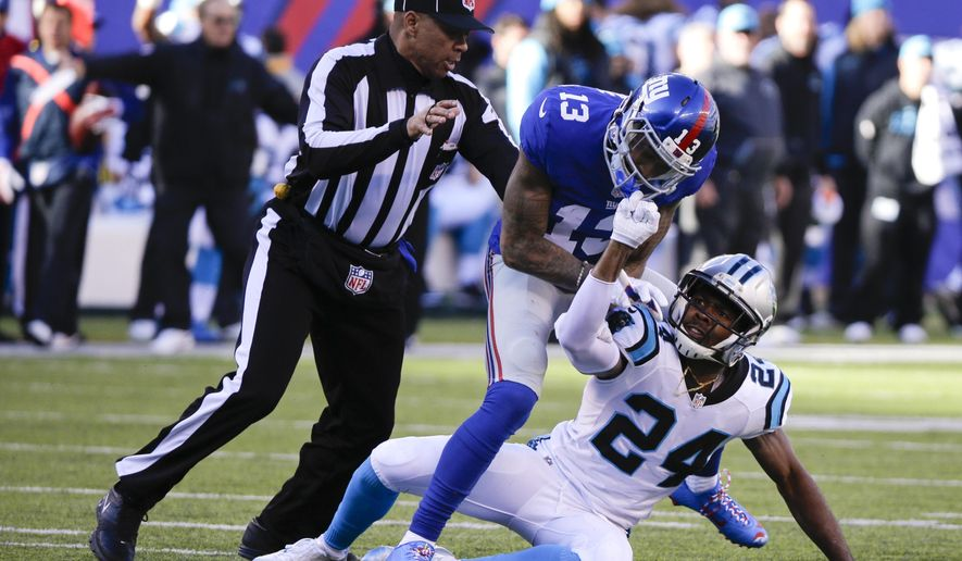 FILE - In this Dec. 20, 2015, file photo, a referee, left, separates New York Giants wide receiver Odell Beckham (13) and Carolina Panthers' Josh Norman (24) during the first half of an NFL football game Sunday, Dec. 20, 2015, in East Rutherford, N.J. The NFL's powerful competition committee is recommending making extra point kicks from the 15-yard line permanent, eliminating all chop blocks and ejecting a player for twice receiving certain unsportsmanlike conduct penalties. (AP Photo/Julie Jacobson, File)