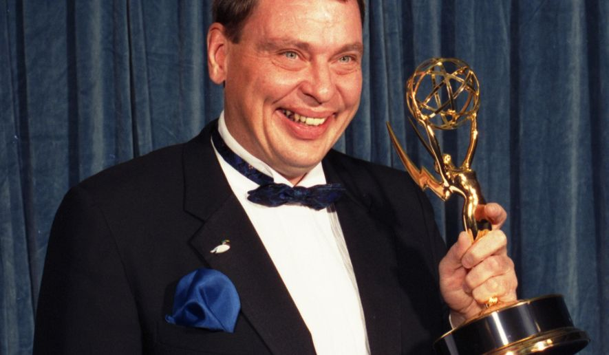 """FILE - In this Sunday, Aug. 28, 1988 file photo, Larry Drake holds the Emmy he won for best supporting actor in a drama series for his role as a mentally challenged character in """"L.A. Law,"""" at the 40th annual Emmy Awards in Pasadena, Calif. Drake, who earned back-to-back Emmys for his portrayal of Benny Stulwicz, was found dead in his Los Angeles-area home on Thursday, March 17, 2016. He was 66. (AP Photo/Lennox McLendon)"""