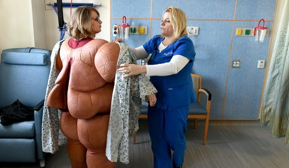A study found that 65 percent of health care providers said they don't address weight management with their patients for fear of embarrassing them, but only 15 percent of patients said they are embarrassed to talk about weight management. (Associated Press/File) **FILE**