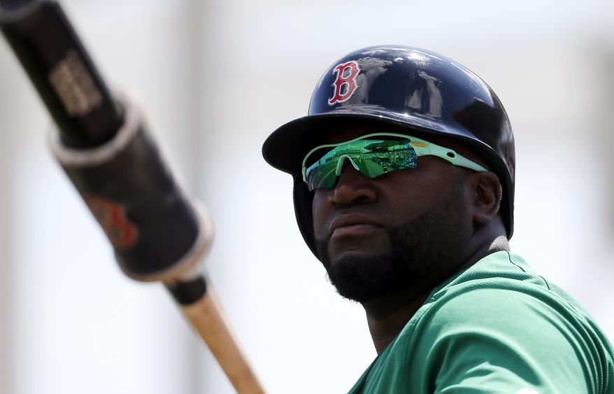 Boston Red Sox designated hitter David Ortiz, wearing green tinted glasses, warms up as he stands on deck in the first inning of a spring training baseball game against the Baltimore Orioles on Thursday, March 17, 2016, in Fort Myers, Fla. The team wore green themed uniforms in observance of St. Patrick's Day. (AP Photo/Tony Gutierrez)
