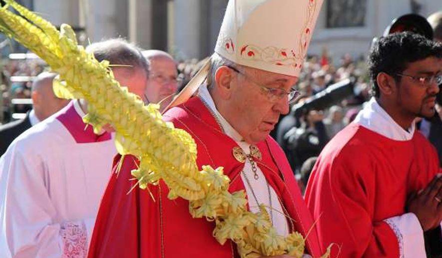 Pope on Palm Sunday (Photo by Bohumil Petrik/CNA)
