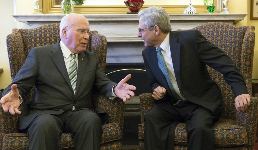 Sen. Patrick Leahy, D-Vt., left, the top Democrat on the Senate Judiciary Committee talks with Judge Merrick Garland, President Barack Obama's choice to replace the late Justice Antonin Scalia on the Supreme Court, on Capitol Hill in Washington, Thursday, March 17, 2016. (AP Photo/J. Scott Applewhite)