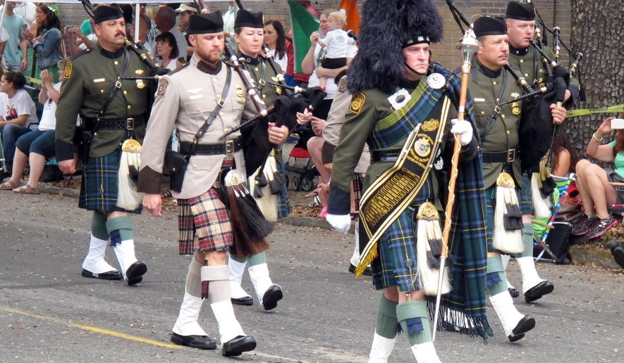 Members of the U.S Customs and Border Patrol Pipes and Drums band march in the St. Patrick's Day parade in Savannah, Ga., Thursday, March 17, 2016. The Savannah celebration, which began with a modest parade by Irish immigrants in 1824, draws thousands of revelers to the coastal Southern city each year. (AP Photo/Russ Bynum)
