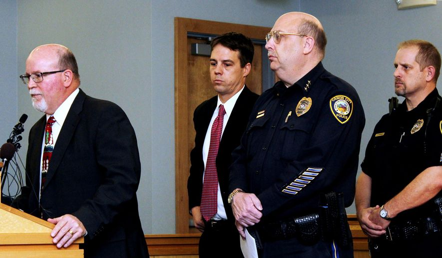 FILE - In this Dec. 9, 2015 file photo, Canon City School Superintendent George Welsh, left, addresses the media, as from second left, District Attorney Thom LeDoux, Canon City Police Chief Paul Schultz and Detective Clint Robertson listen during a news conference, in Canon City, Colo., regarding an investigation into nude photo sexting among high school students. Rampant teenage sexting has prompted dozens of states to consider the differences between adolescent flirting and actual child pornography- but proposals to soften criminal penalties when minors send each other explicit images are running into opposition from researchers and teens who say consensual sexting shouldn't be a crime at all. (Tracy Harmon/The Pueblo Chieftain via AP, File) MANDATORY CREDIT