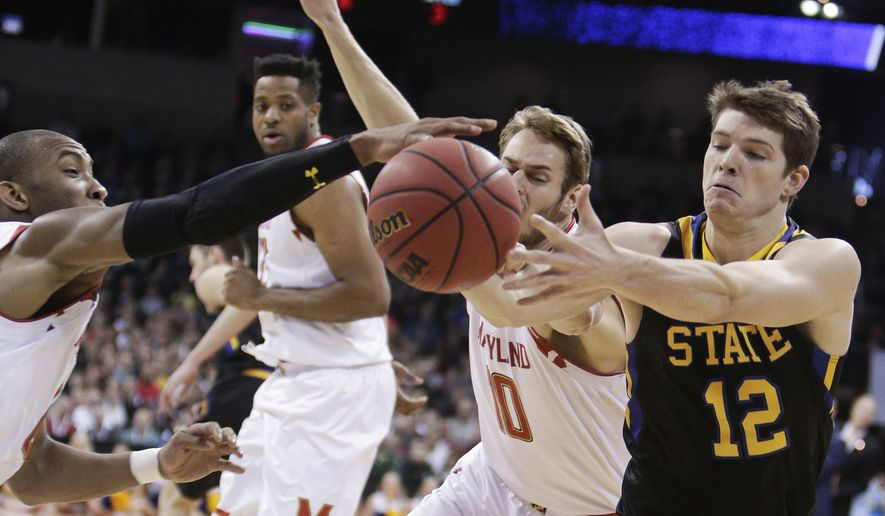 South Dakota State guard Keaton Moffitt (12) goes after the ball against Maryland forward Jake Layman (10) and guard Rasheed Sulaimon during the first half of a first-round men's college basketball game in the NCAA Tournament in Spokane, Wash., Friday, March 18, 2016. (AP Photo/Young Kwak)