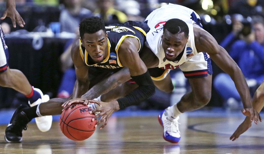 Wichita State forward Markis McDuffie, left, and Arizona guard Kadeem Allen, right, vie for a loose ball during the first half of a first-round game of the NCAA men's college basketball tournament in Providence, R.I., Thursday, March 17, 2016. (AP Photo/Charles Krupa)