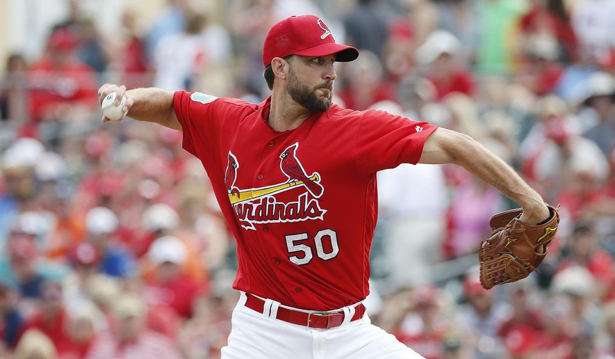 St. Louis Cardinals' starting pitcher Adam Wainwright delivers a pitch during the first inning of an exhibition spring training baseball game against the Detroit Tigers, Friday, March 18, 2016, in Jupiter, Fla. (AP Photo/Brynn Anderson)