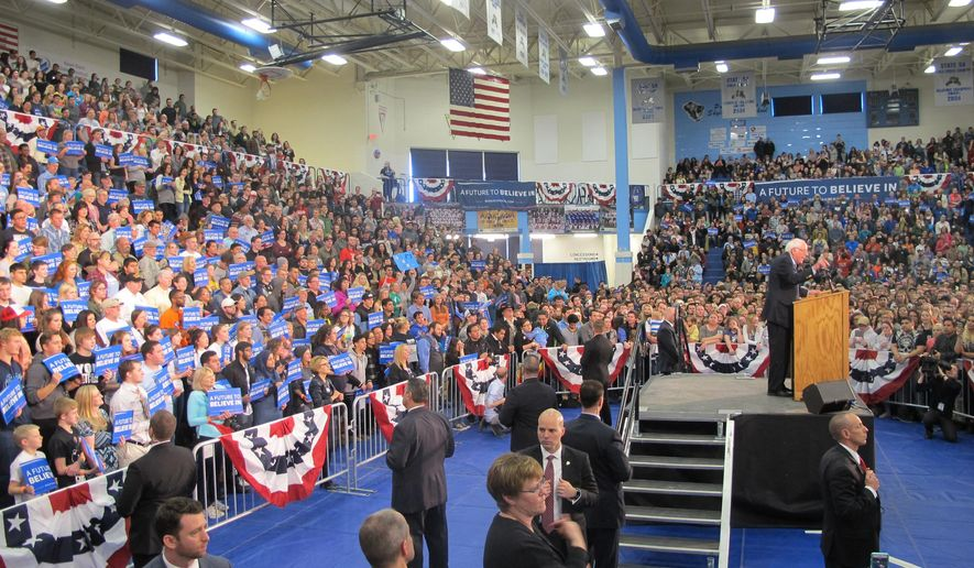 Democratic presidential candidate, Sen. Bernie Sanders, I-Vt., speaks to a crowded gymnasium full of supporters at a campaign rally at Skyline High School in Idaho Falls, Idaho, Friday, March 18, 2016. (AP Photo/Kimberlee Kruesi)