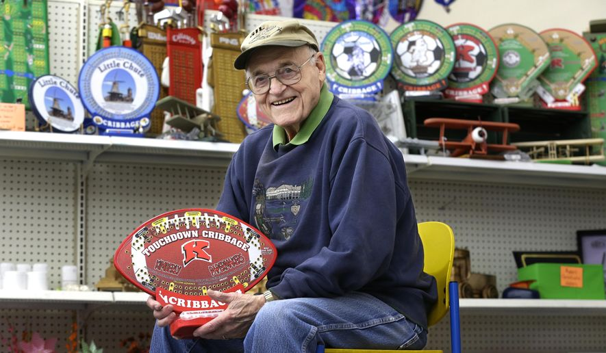 ADVANCE FOR MONDAY MARCH 21 AND THEREAFTER - In a March 5, 2016 photo, Gib Miller, 88, of Appleton shows off his custom made cribbage boards at Part and Print in Little Chute, Wis. (Dan Powers/The Post-Crescent via AP) NO SALES; MANDATORY CREDIT