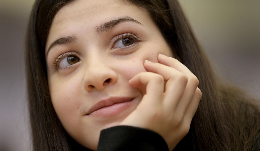 Syrian swimmer Yusra Mardini who fled to Germany with her family and who is currently training with a local swimming club attends a joint press conference of the International Olympic Committee (IOC) and the German Olympic Sports Confederation (DOSB) in Berlin, Germany, Friday, March 18, 2016. The IOC is supporting refugee athletes who could potentially qualify for the Olympic Games Rio de Janeiro 2016. One of them is 17 year old Syrian swimmer Yusra Mardini. (AP Photo/Michael Sohn)