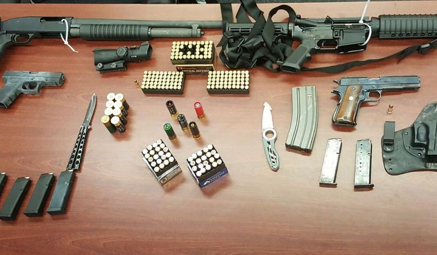 In this undated photo provided by the New York City Police Department, a cache of guns and ammunition confiscated by police during a motor vehicle stop on Wednesday, May 16, 2016 are shown in New York. A search of the car revealed an assault rifle, shotgun, and three semi-automatic handguns, plus high capacity magazines and 100 rounds of hollow-tip bullets and armor piercing ammunition. Three people were arrested on weapons charges. (New York City Police Department via AP)