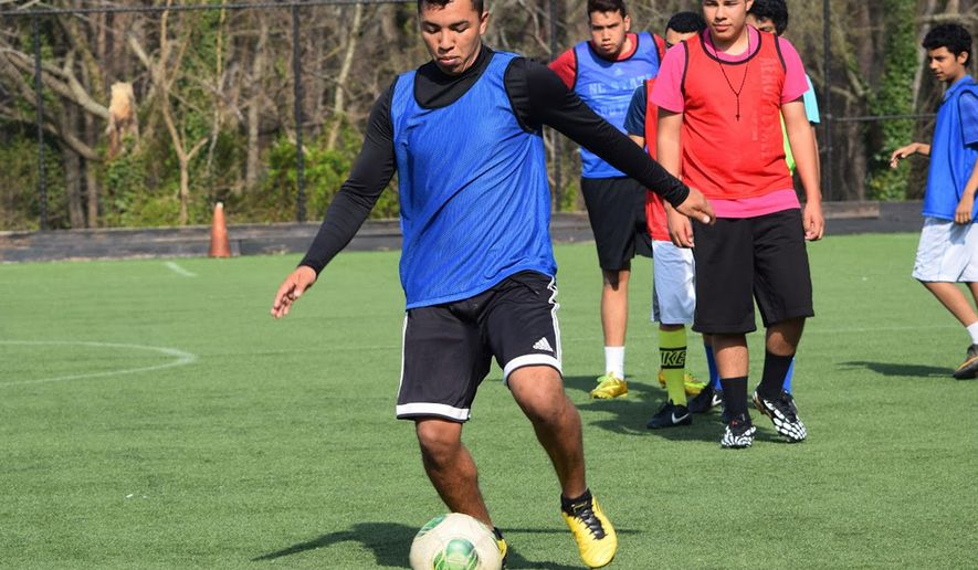 This photo provided by the Acosta family shows Wildin Acosta at soccer pracrice. The Obama administration is openly stepping up efforts to find and deport immigrants who were part of the 2014 surge of illegal crossings by unaccompanied children and families. One of those unaccompanied children-turned-adults targeted by Immigration and Customs Enforcement is 19-year-old Wildin David Guillen Acosta. He said he came to the United States from Honduras by bus, car and on foot after a gang member threatened to kill him. (Ivan Almonte/Acosta family via AP)