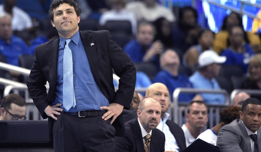 FILE - In this March 12, 2016, file photo, Memphis head coach Josh Pastner, left, watches from the sideline during the second half of an NCAA college basketball game against Tulane in the semifinals of the American Athletic Conference men's tournament in Orlando, Fla. Memphis is sticking with coach Pastner even though the school missed the NCAA Tournament for a second straight season, the school announced Friday, March 18, 2016.. (AP Photo/Phelan M. Ebenhack, File)