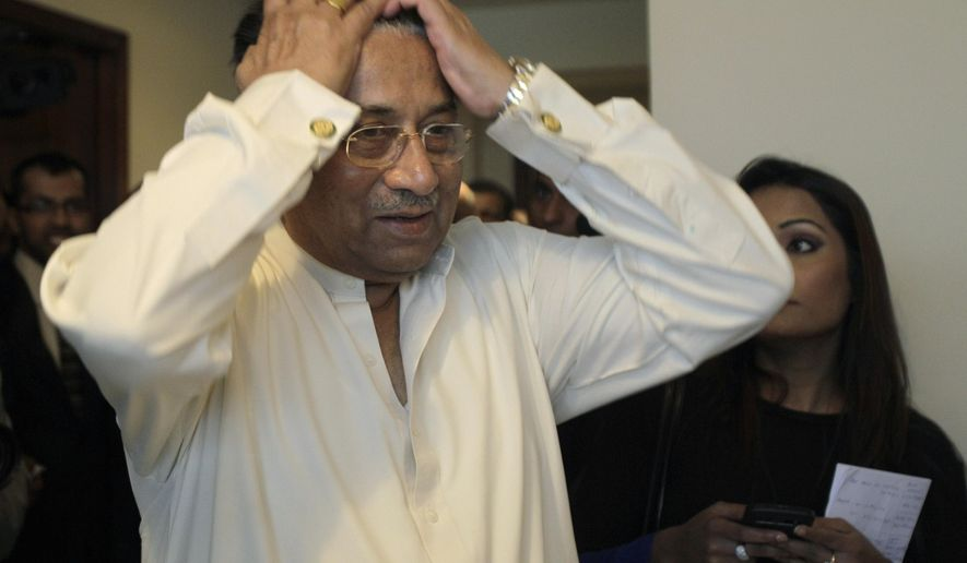 FILE - In this Sunday, March 24, 2013 file photo, former Pakistani President Pervez Musharraf reacts while arriving at his office for a press briefing before leaving to Karachi in Dubai, United Arab Emirates. The former military ruler, who faces trials for treason and murder, has left Pakistan for treatment abroad in Dubai and has pledged to return after treatment for a back issue. (AP Photo/Kamran Jebreili, File)