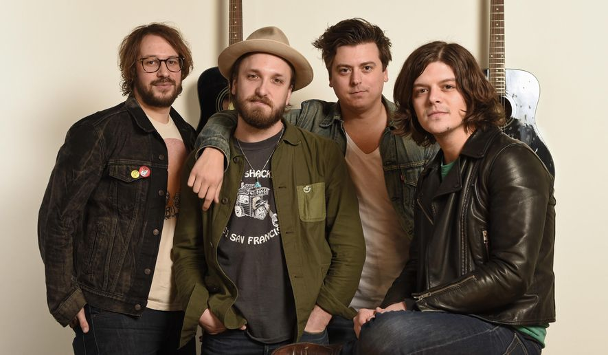"""In this Feb. 24, 2016 photo, members of The Wild Feathers, from left, Ben Dumas, Taylor Burns, Ricky Young, and Joel King, pose in Nashville, Tenn., to promote their sophomore album, """"Lonely is a Lifetime."""" (AP Photo/Sanford Myers)"""