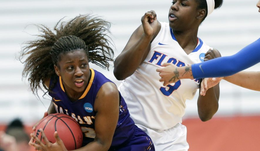 Albany guard Zakiya Saunders, left, keeps the ball away from Florida guard January Miller (3) during the first half of a first-round women's college basketball game in the NCAA Tournament on Friday, March 18, 2016, in Syracuse, N.Y. (AP Photo/Mike Groll)