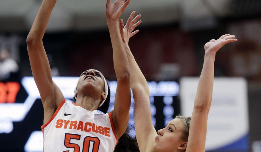 Syracuse center Briana Day (50) shoots over Army forward Madison Hovren (14) during the first half of a first-round women's college basketball game in the NCAA Tournament on Friday, March 18, 2016, in Syracuse, N.Y. (AP Photo/Mike Groll)