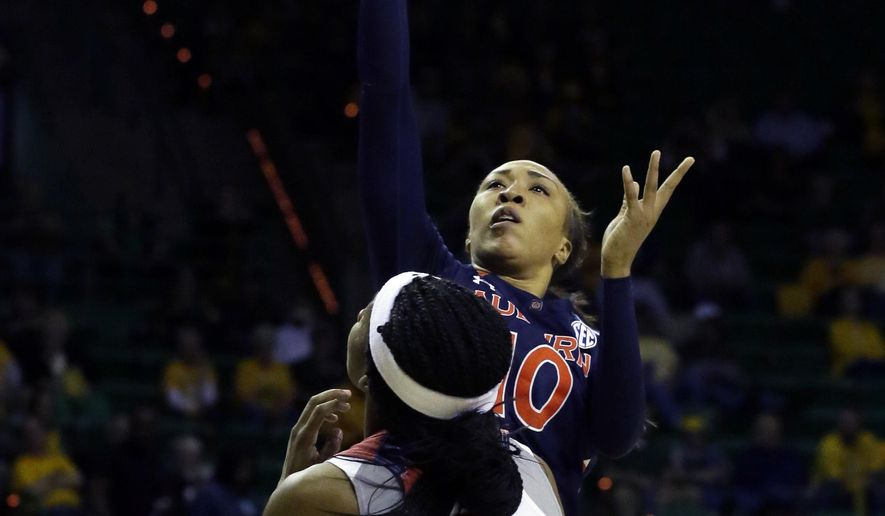 Auburn guard Brandy Montgomery (10) shoots over St. John's guard Aliyyah Handford (3) during the first half of a first-round women's college basketball game in the NCAA Tournament Friday, March 18, 2016, in Waco, Texas. (AP Photo/LM Otero)