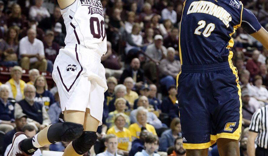 Mississippi State guard Dominique Dillingham (00) attempts a shot over Chattanooga guard Keiana Gilbert (20) during the first half in a first-round women's college basketball game in the NCAA Tournament, Friday, March 18, 2016, in Starkville, Miss. (AP Photo/Rogelio V. Solis)