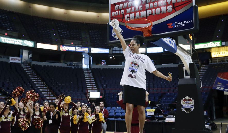 FILE - In this Monday, March 7, 2016, file photo, Iona head coach Billi Godsey holds the net after cutting it from the rim following her team's win over Quinnipiac in an NCAA women's college basketball game in the championship of the Metro Atlantic Athletic Conference tournament in Albany, N.Y. Iona's reward for reaching the women's NCAA Tournament for the first time: An opening-round matchup Saturday against second-seeded Maryland on the Terrapins' home floor, (AP Photo/Mike Groll, File0