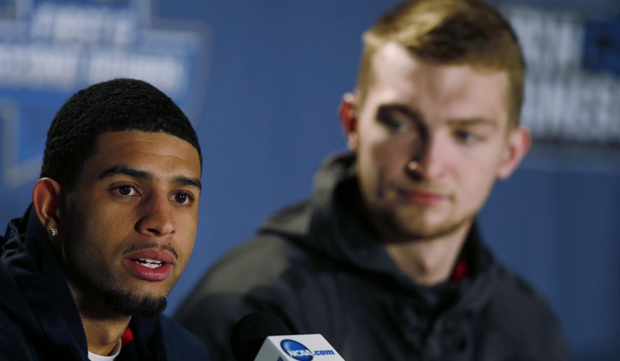 Gonzaga guard Josh Perkins, front, responds to questions as center Domantas Sabonis looks on during a news conference as the team prepares for a second-round men's college basketball game Friday, March 18, 2016, in the NCAA Tournament in Denver. Utah will face Gonzaga on Saturday. (AP Photo/David Zalubowski)