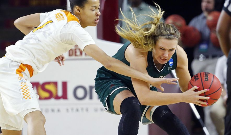 Green Bay forward Jessica Lindstrom, right, battles for the ball as Tennessee center Nia Moore, left, reaches in during the first half of a first-round women's college basketball game in the NCAA Tournament, Friday, March 18, 2016, in Tempe, Ariz. (AP Photo/Matt York)