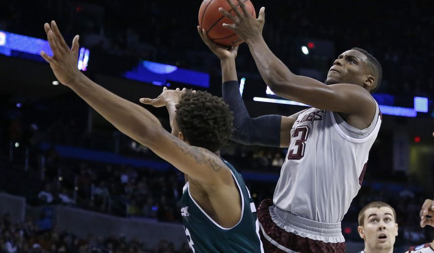 Texas A&M guard Danuel House, right, shoots over Green Bay forward Jamar Hurdle, left, in the first half of a first-round men's college basketball game in the NCAA Tournament, Friday, March 18, 2016, in Oklahoma City. (AP Photo/Sue Ogrocki)