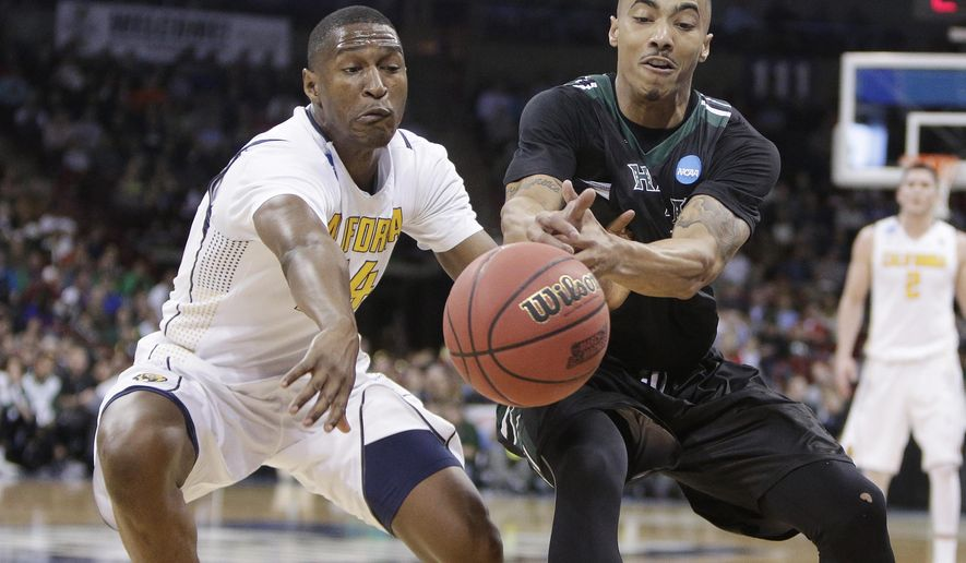 California guard Jordan Mathews, left, and Hawaii guard Quincy Smith go after a loose ball during the second half of a first-round men's college basketball game in the NCAA Tournament in Spokane, Wash., Friday, March 18, 2016. Hawaii won 77-66. (AP Photo/Young Kwak)