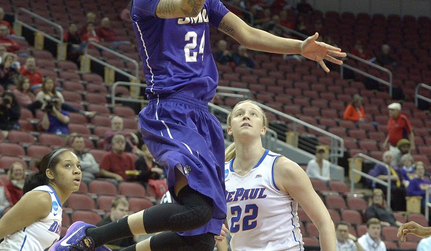 James Madison's Jazmon Gwathmey (24) goes in for a layup past the defense of DePaul's Brooke Schulte (22) during the first half of a first-round women's college basketball game in the NCAA Tournament in Louisville, Ky., Friday, March 18, 2016. (AP Photo/Timothy D. Easley)