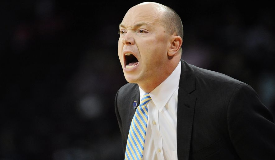 George Washington head coach Jonathan Tsipis reacts during a first-round women's college basketball game against Kansas State in the NCAA Tournament on Friday, March 18, 2016, in Columbia, S.C.  (AP Photo/Rainier Ehrhardt)
